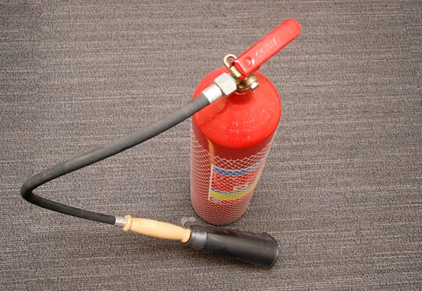 A stored-pressure fire extingu: A fire extinguisher is an active fire protection device used to extinguish or control small fires, often in emergency situations
