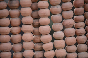 Terracotta beads: A screen made of terracotta beads in the famous Rock Garden in Chandigarh, India.Please drop in a comment on your usage if possible.