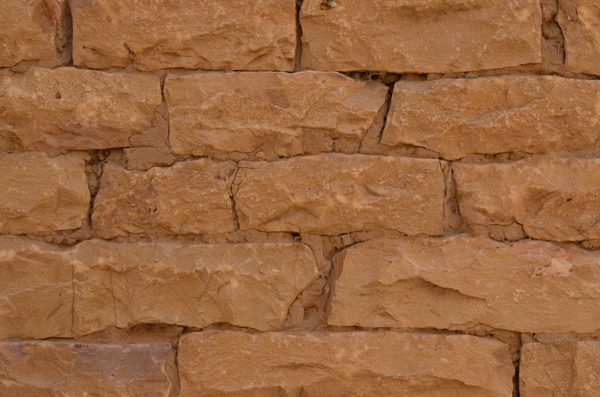 Stone brick wall texture: A selection from the various stone walls of Jaisalmer fort in Rajasthan, India.