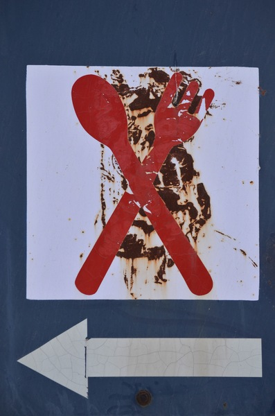 Restaurant sign board: Rusting signboard on the NH15 highway in Rajasthan, India for a restaurant ahead.