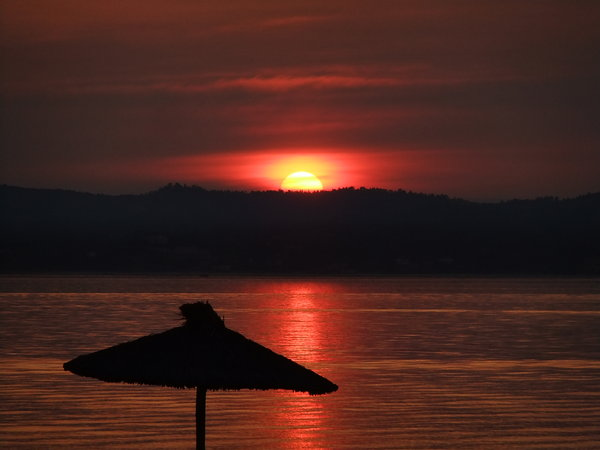 Sunset in Thassos: A nice red sunset across the beach