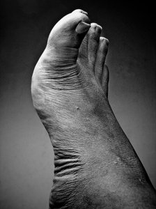 foot in black and white: I photographed this foot using a prosummer camera, and pushed the texture and the detail using Adobe Lightroom.