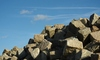 Pile of paving stones: Pile of paving stones with blue sky and some clouds as background