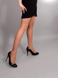 Woman with high heels: Woman in dress and with high heels shoe