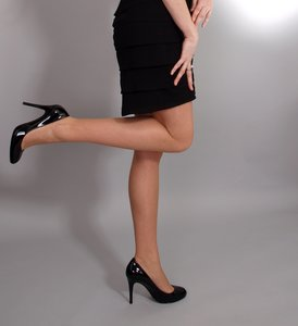 Woman with high heels, one kne: Woman with high heels standing on one leg and having one knee bended