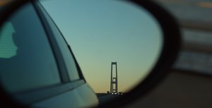 Looking back: Great Belt Bridge in the sidemirror