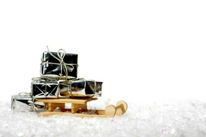 Sledge in snow with gifts: Sledge in snow with silver wrapped gifts