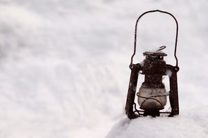 Paraffin lamp in snow: An old paraffin (kerosene) lamp in the snow.