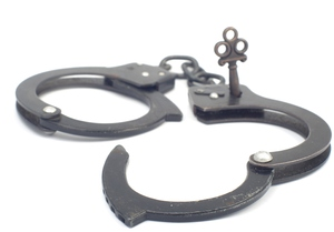 Handcuffs with key: Metal handcuffs with key inserted
