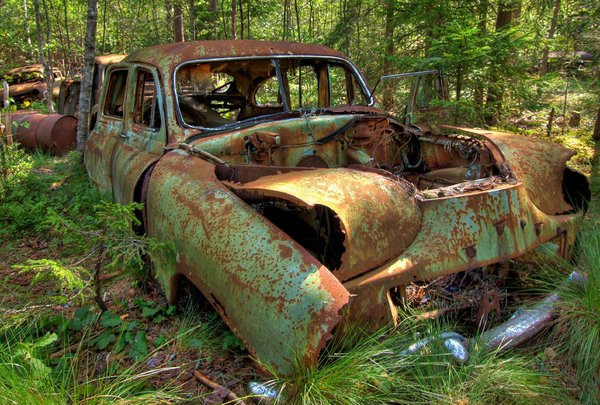 Disintegration - HDR: Old car sitting in a forrest for 50 years. The picture is HDR derived from five individual pictures.