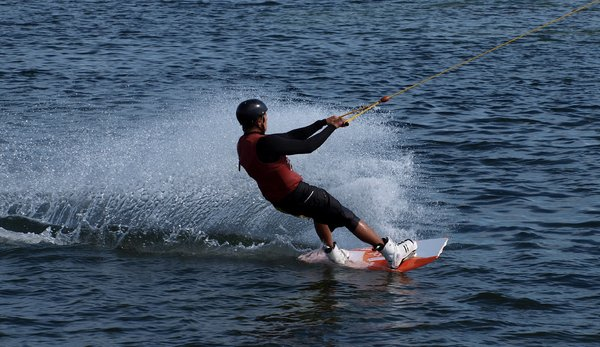 Wake board: Surfin wake board with lots of speed and spray