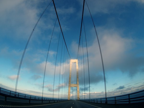 Bridge driving: Passing a suspension bridge (Great Belt in denmark); using fisheye lens.
