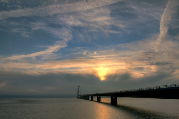 Bridge and Sky - HDR: Great Belt Bridge in Denmark chossing Great Baelt in sunset. The images is HDR