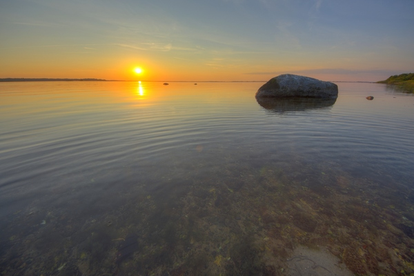 Sunset in the calm - HDR: Sunset in calm waters. The image is HDR.