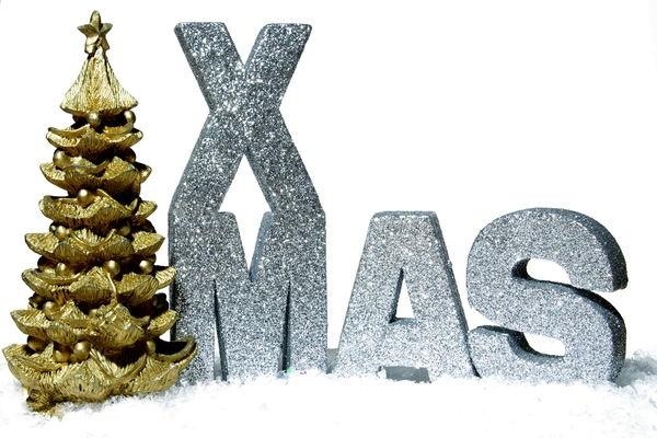Xmas tree: Golden christmastree and silver letters in snow.