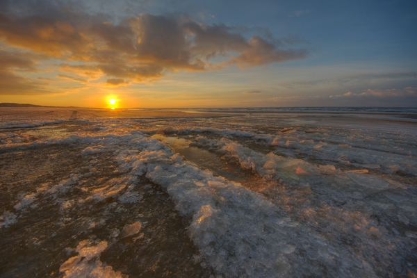 Sunset in the sea: Sunset in the sea woth ice in the coastline.