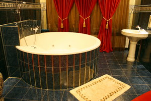 romantic interior: luxurious bathroom with red courtain