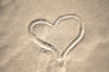Sand heart 1: A sand heart drawn in the sand on the beach