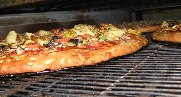 Delicious Too: Pizza cooking inside oven