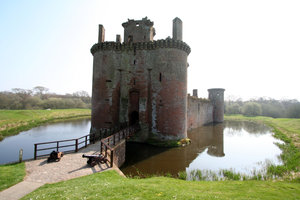 Caerlaverock Castle  1: Surrounded by a double moat and hundreds of acres of flat marshy willow woods , Caerlaverock was built to control the South-West entrance to Scotland which in early times was the waterway across the Solway Firth. Building began in about 1277, and by 1300