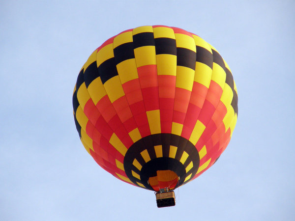 Hot Air Balloon: Sailing over the city in a hot air balloon.