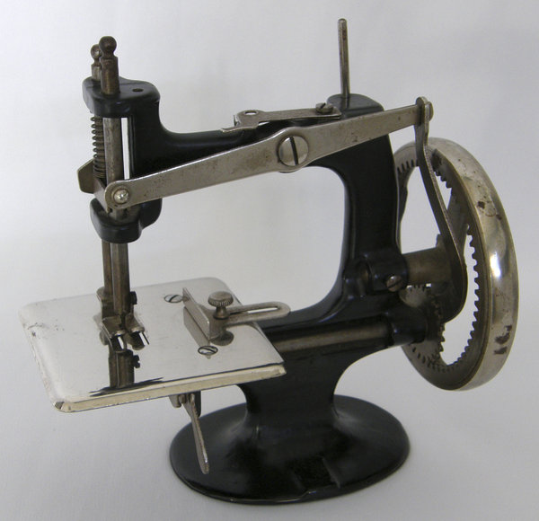 Sewing Machine: Working sewing machine marketed as a toy in the early 1900's.