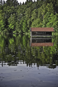 cottage in the lake: a small cottage which is definitely built in the water...? Found in a small lake called 'Hackensee' in Bavaria, Germany