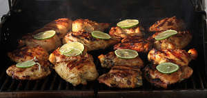 Chicken on the Barbecue Grill: Chicken with lime being grilled outside