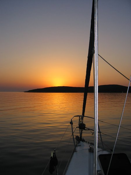 sailing into sunset: I know, another sunset, but this is a little bit different, isn it? Photo taken while sailing in the Adriatic see.