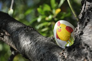 Easter egg waiting to be found: Easter egg painted by grandma in the forest waiting to be found!
