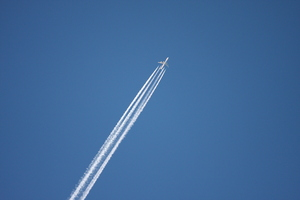 Jet with contrails: Jet (presumably a 747 Jumbo)  in about 30,000 ft altitude with contrails
