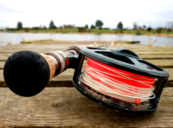 Fly Fishing: Shots of Fly fishing reel lying on the ground