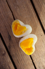 Heart Shaped Eggs on a old woo: Heart Shaped Eggs on a old wooden table.