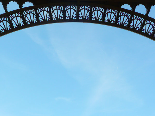Eiffel tower arch border: Closeup of one of the lower arches of the Eiffel tower in Paris. Maybe useful as border?