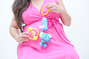 Pregnancy Portrait 2: Photo of pregnant woman with baby toys