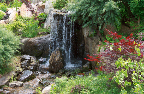 Garden Waterfall: A small waterfall in a park in Europe.