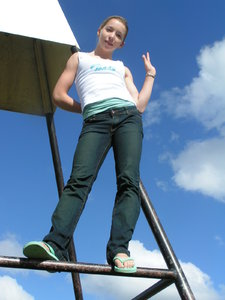 front view teen at Trig Statio: Mt Hobson, Auckland, New Zealand after recreational hike in Feb 2005.