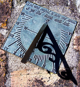 sundial: Sundial face on rough brick.   sorry for the angle, but trying to get the shadow in the pic.