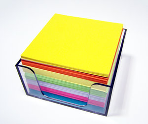 Take a message...: Memo cube of coloured paper squares in the office.