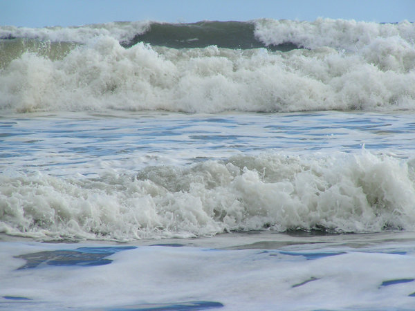 small waves breaking: New Zealand beach foam