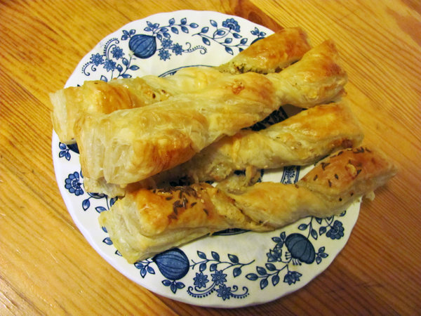puff pastry: puff pastry with cheese, caraway and sesame on a rustic plate