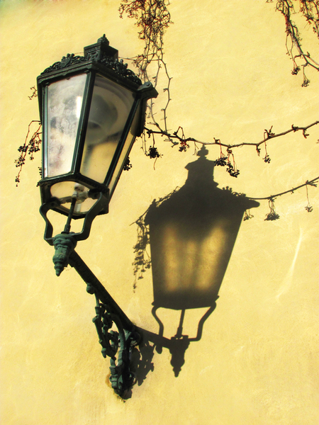 Lantern on yellow wall: Lantern on yellow wall with picturesque shadow