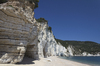 Banded chalk cliff: Chalk cliff with bands of brown flint in southern Italy.