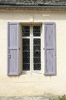 Window with shutters: A leaded glass window with shutters in a chateau in France.