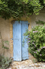Old blue shutters: Old blue door shutters on a house in the Dordogne, France.
