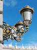 Ornamental streetlamps: A pair of ornamental wall-mounted streetlamps outside the Palacio Real de Madrid, Spain. Photography in this area was freely permitted.
