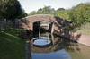 Canal bridge: A footbridge over a rural canal in West Sussex, England.