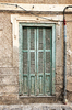 Grungy green doors: Old doors in a town in Majorca, Balearic Islands, Spain.