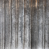 Old wood panelling: Old wooden panelling on the outside of a church in Essex, England.