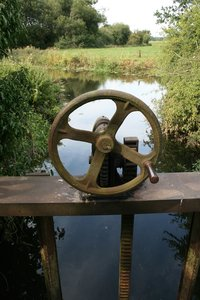 Sluice gate: An old sluice gate on a small river in West Sussex, England.